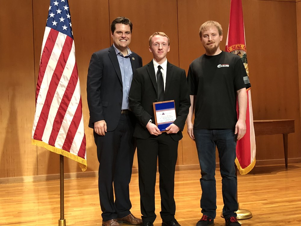 1st Place Winner   This young man is amazing! He built a stock training application using multiple computer science disciplines, including a comprehensive back end with multiple programming languages, SQL database, and intuitive user interface. Lets not forget it's tied into a real-time stock ticker! Congressman Gaetz, 1st Place Winner, and Beast Code, CEO - Matt Z.