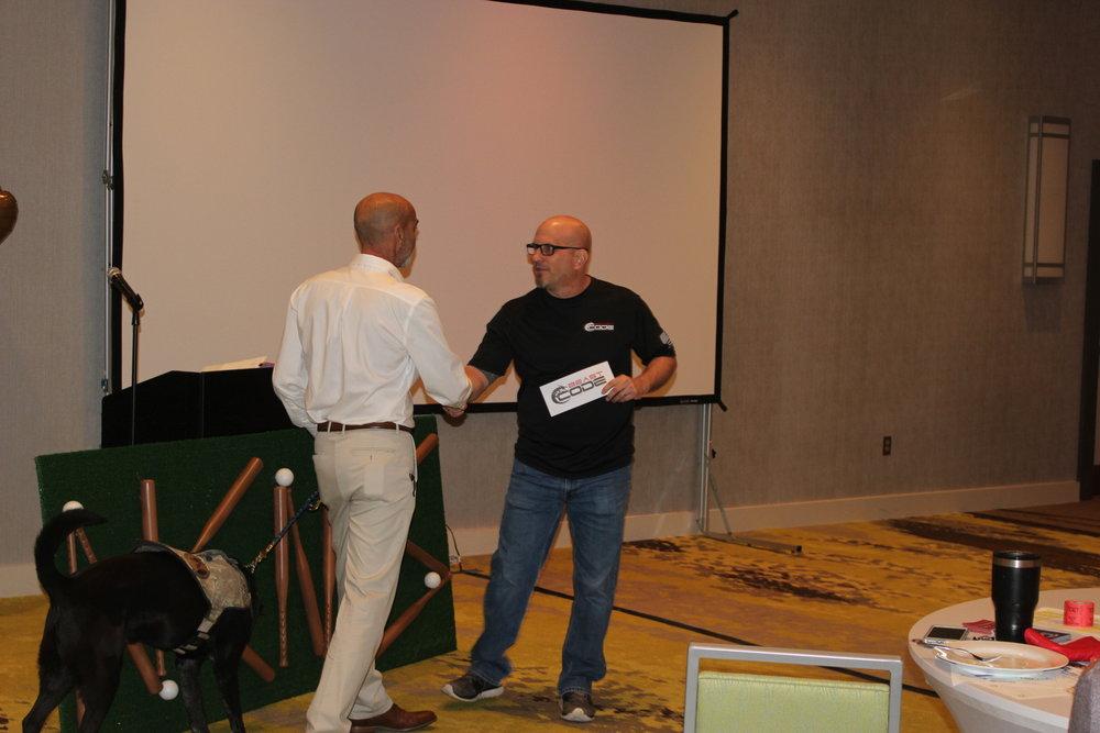 John presenting donation for K9 Team sponsorship