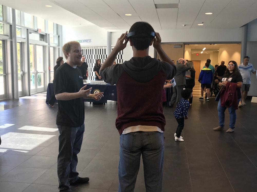 CEO, Matthew Zimmermann, walking a student through a software demonstration.