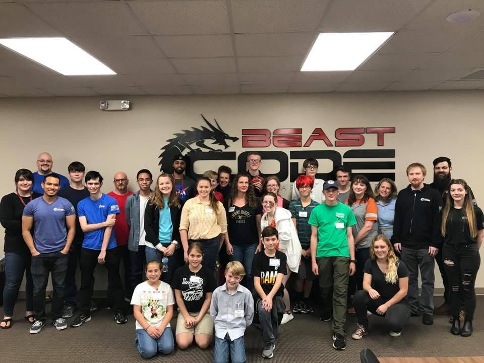 The students and the Beast Code team pose for a group picture afterwards.