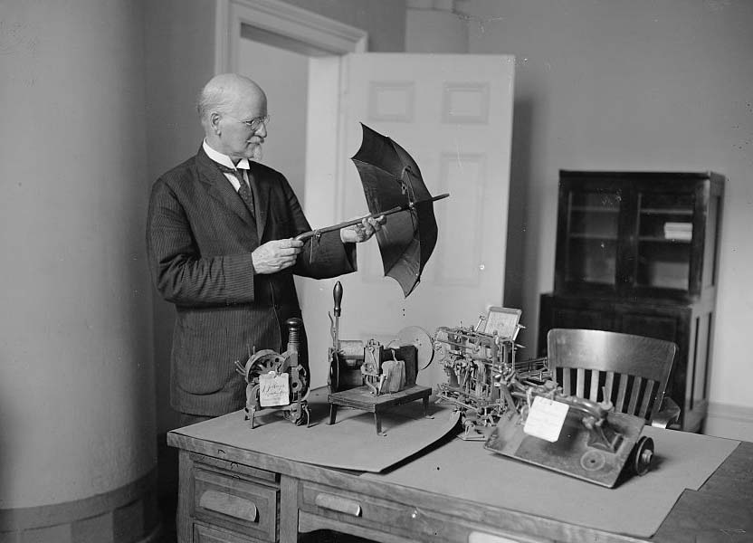 Patent Commissioner examines models in 1925. Library of Congress image