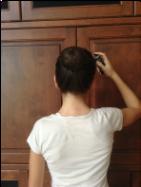 5.Spray hairspray over bun and head until it feels secure.