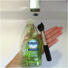 5. Apply a pea-size of the antibacterial soap in the center of the bristles. A pea-size goes a long way, when cleaning makeup brushes.