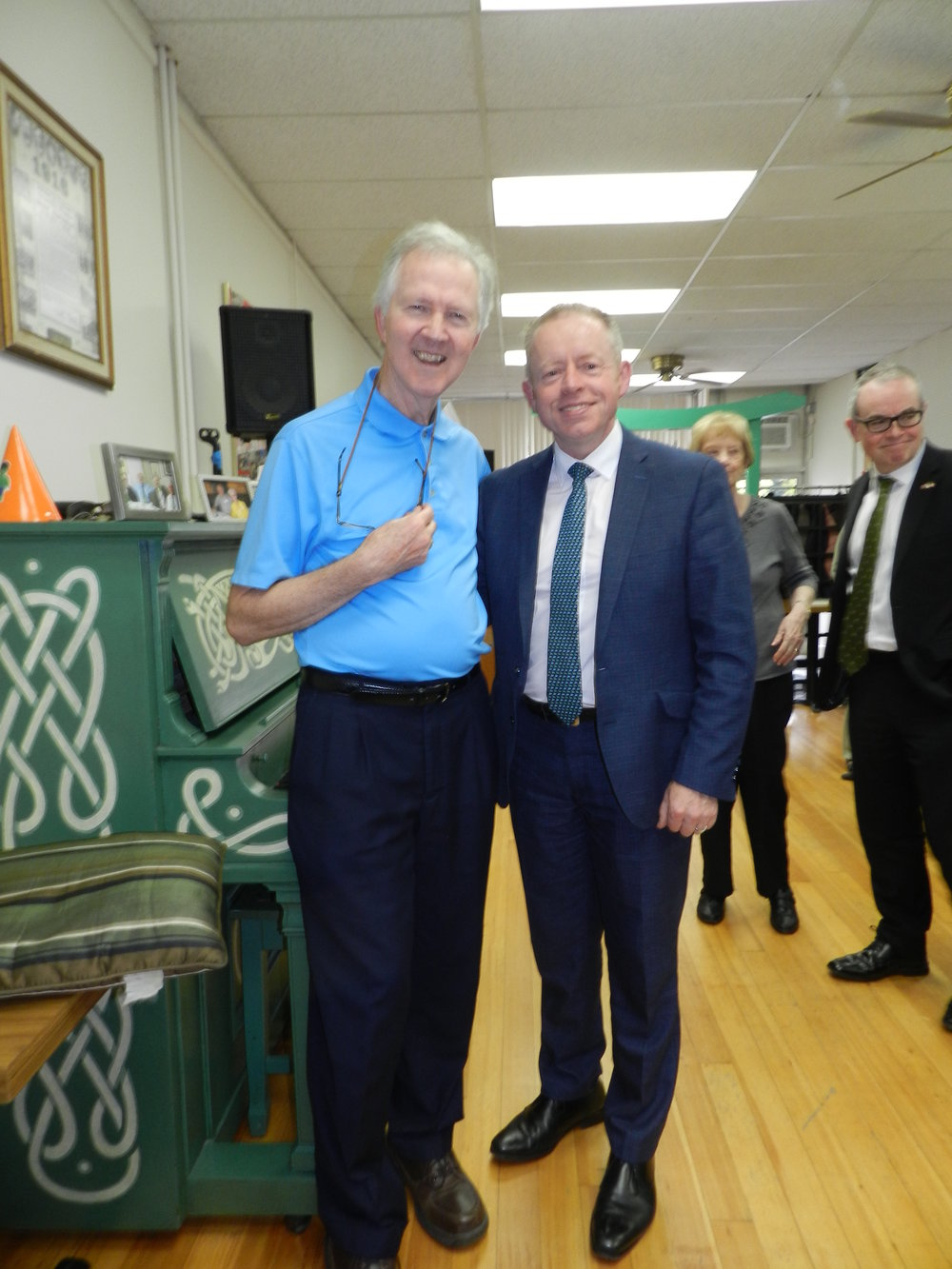 Pictured above is Minister Ciaran Cannon, T.D. (right) along with Aiden Scannel, vice-president of the Emerald Isle Seniors Society