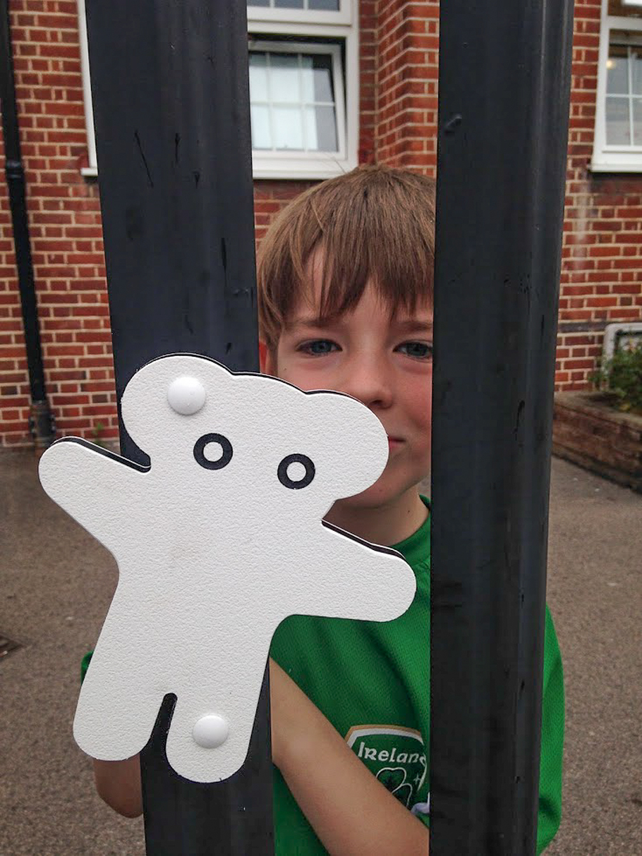 Oisin fitting 'snowy' to the Cromer Road Primary School Railings.