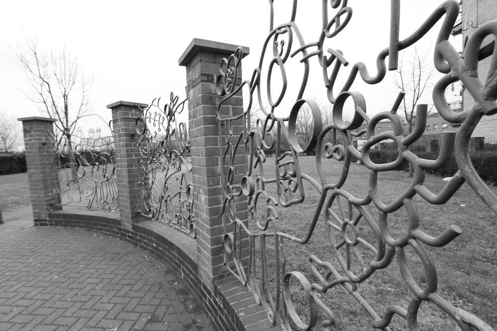 Stonebridge Park forged steel railings, by Lara Sparey. Forged steel railings forming the entrance to Stonebridge Park recreation ground