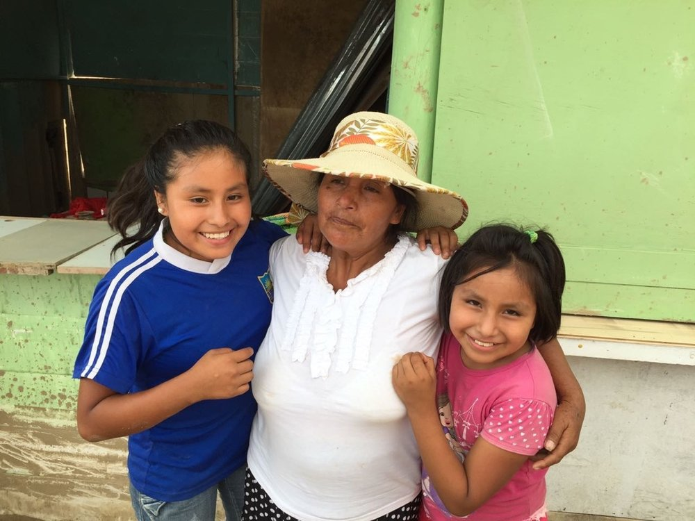 Two girls from Casa Hogar reunited with their mother after the floods destroyed her business and home. All thankful for life and family.