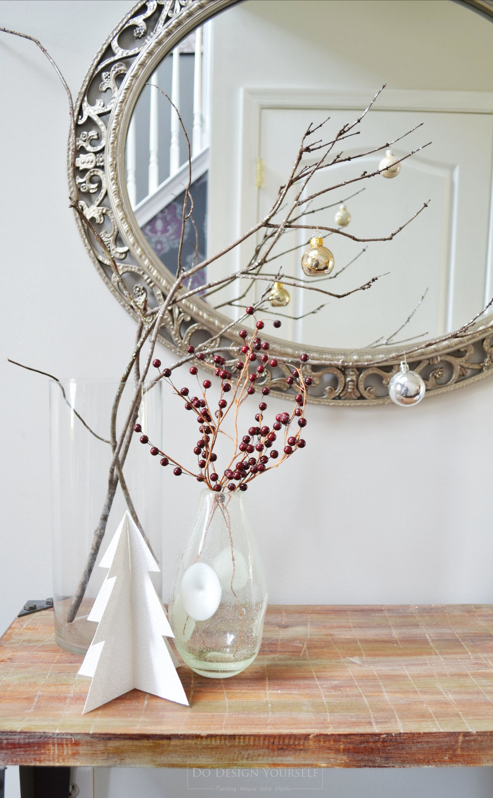 Looking for easy and nearly free Christmas decor idea. See our entryway decor idea that takes minimum time and is very cheap, yet elegant. Decorate with tree brunches and Christmas tree ornaments.