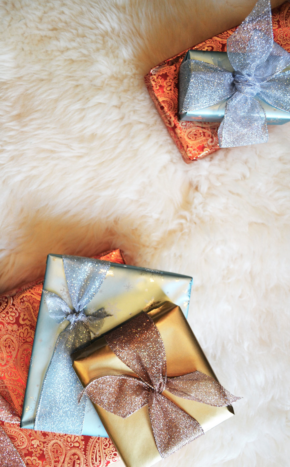 Red, sky blue, and gold gift paper wrapped gifts on a white ship skin.