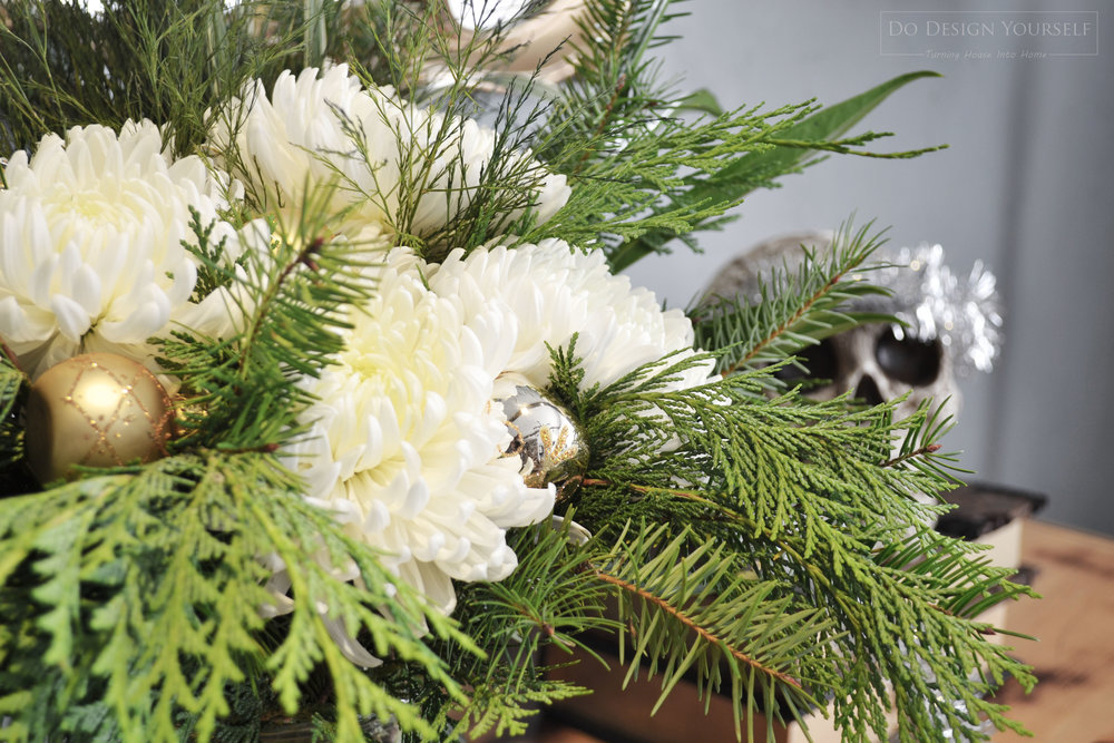 White flowers and Christmas greenery for easy, beautiful, and budget friendly Christmas flower arrangement.