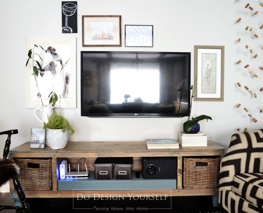Decorate around the TV stand with gallery wall