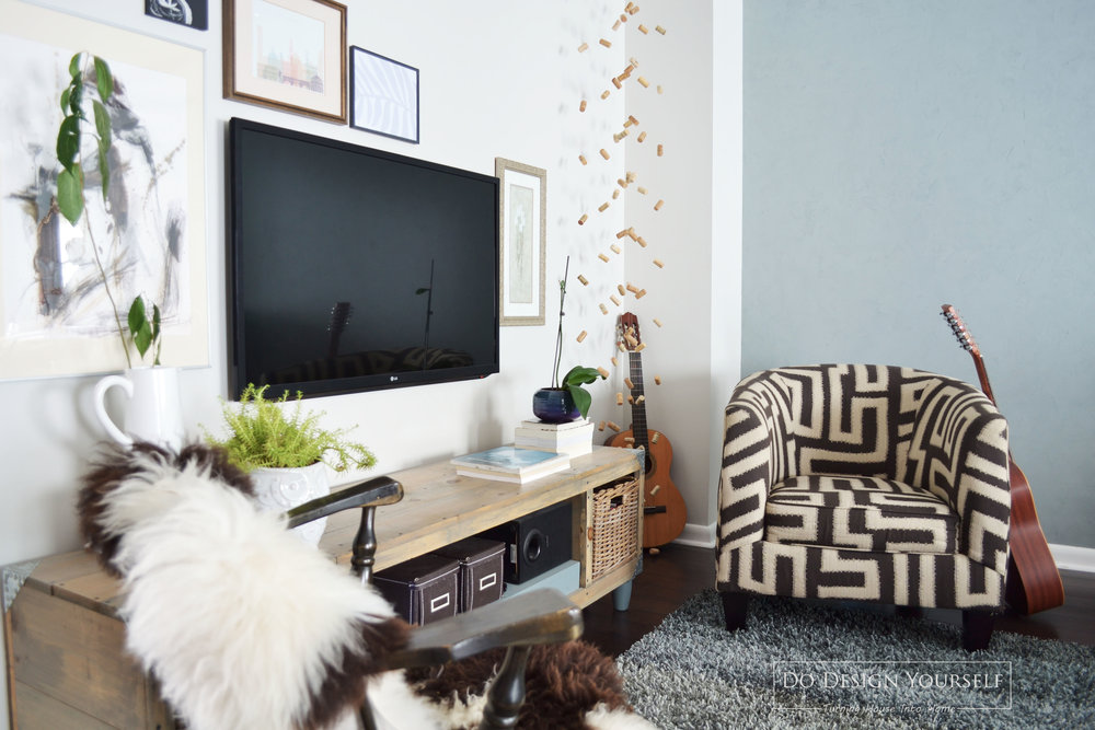 decorate around the TV with gallery wall and indoor plants