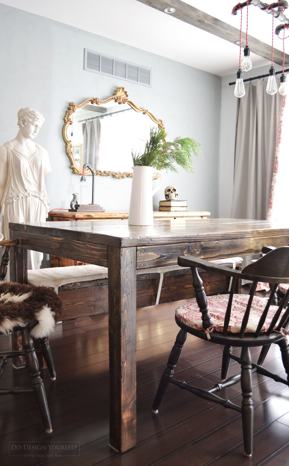 DIY Farmhouse table for dining room with classic and industrial elements.