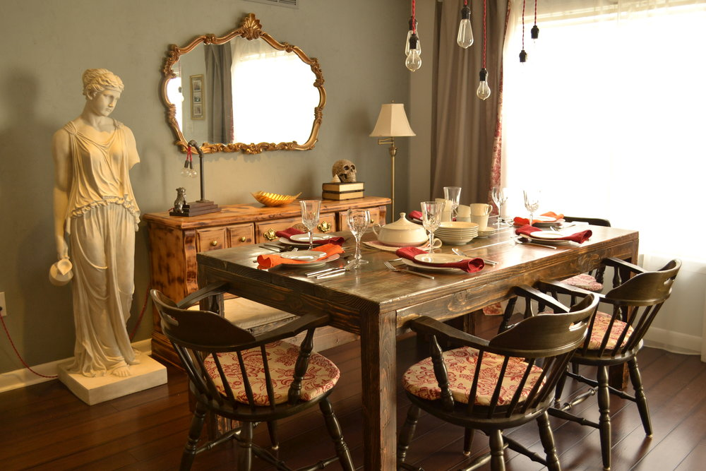 Dining room with DIY farmhouse dining table and Swiss chairs