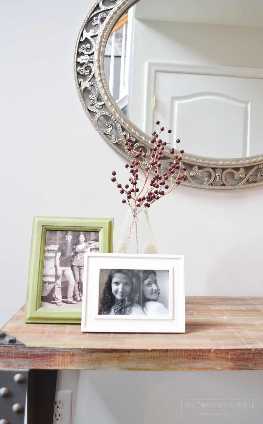 Decorate with the personal photos arranging them into vignettes in odd numbers