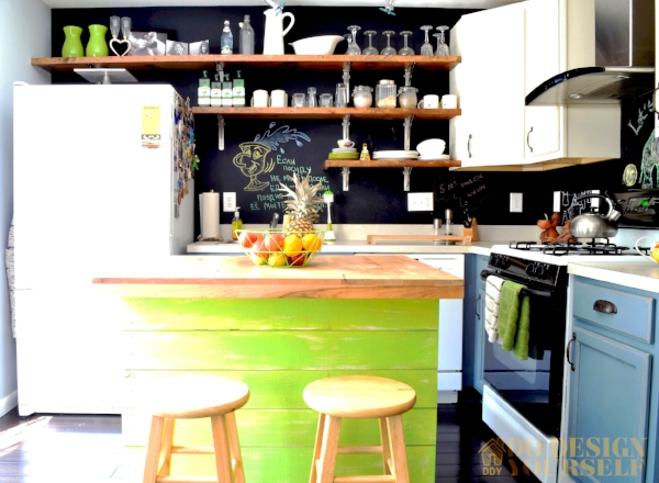 Colorful blue and lime green kitchen with open shelves and chalkboard walls