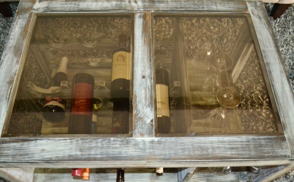 DIY coffee table with wine and wine glasses racks - ideal wine storage solution for small space