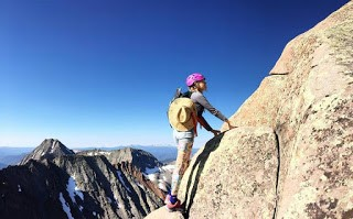 Typical photo of Ellie crushing mountains with an atypical adventure hat