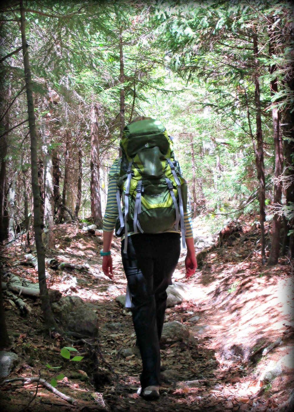 Hiking with a heavy pack. Photo Credit: Erin Sicher
