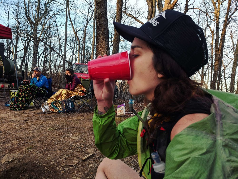 Taking a Fireball shot at the 45 mile cutoff point. Races in the South entail alcohol being offered to you at every aid station. It was much needed at this point. Image by: Chris Kumm (@iliketrails)