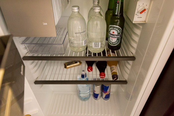 Picture of three water bottles inside mini bar