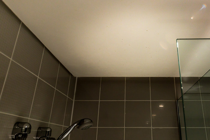 Picture of dirt on shower ceiling in hotel bathroom