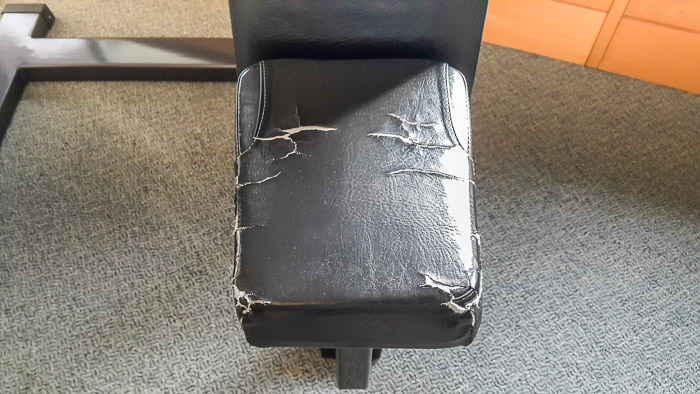 Cracked upholstery on hotel gym equipment