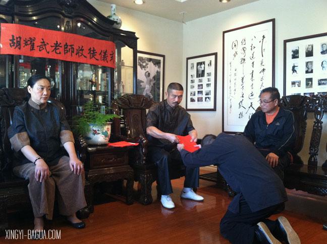Student J. Matthew Brand bows to Master Hu.