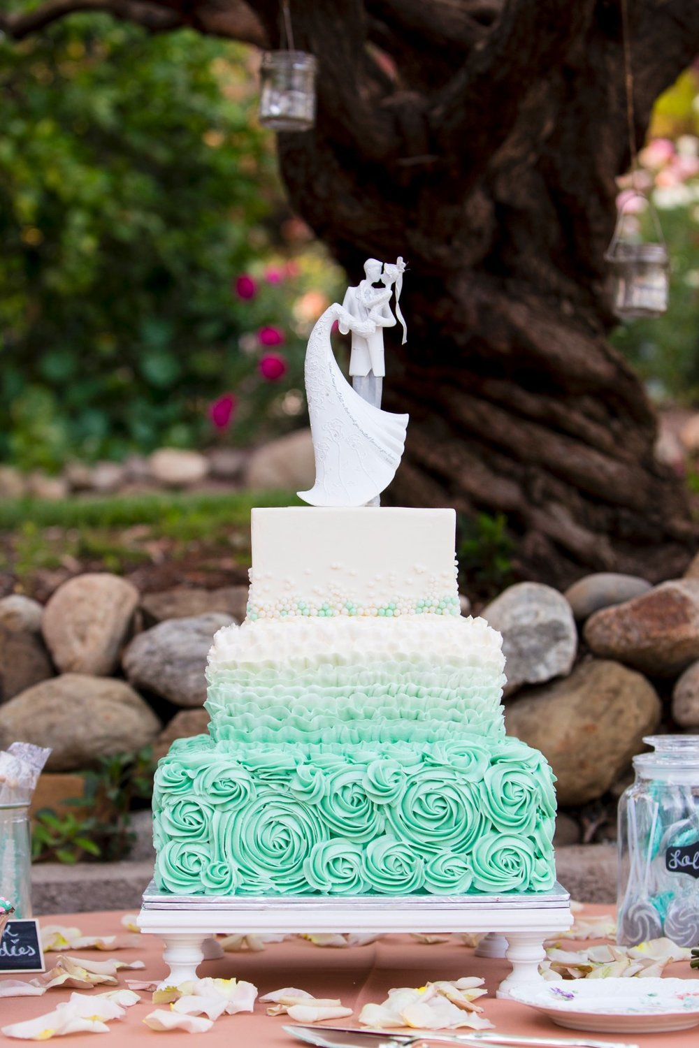 Love the intricate details on this cake. Matched the mint wedding colors perfectly, the fade from dark to light is particularly unique. Stunning! Cake by Sweet Arleens