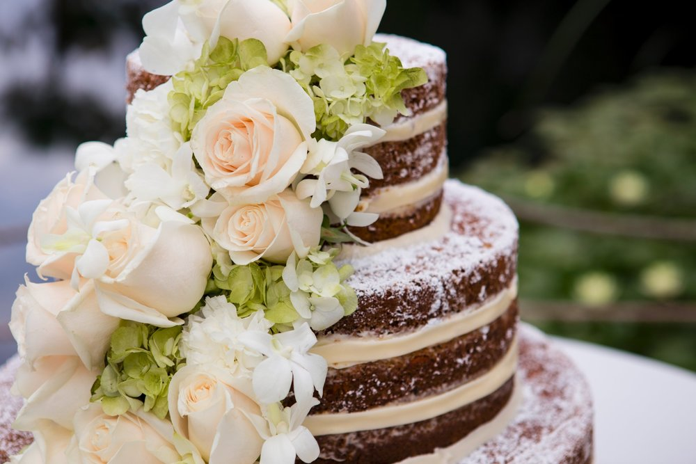 I'm crazy about this naked wedding cake trend. Show off the layers of your cake by leaving off the frosting and fondant, leave it bare and beautiful. Adorn with fresh flowers to add a touch of elegance. Cake by Cheesecake House / Flowers by Floral Sensations