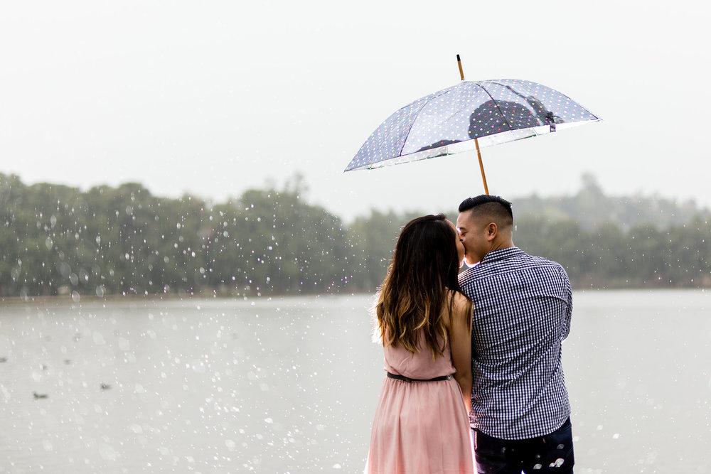 kissing-rain-umbrella-engagement.jpeg
