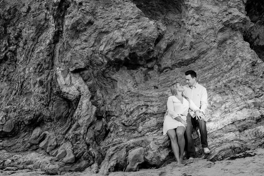 engagement-photos-on-the-rocks-beach.jpeg