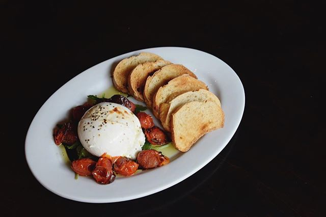 Joining our new Bonanza Bread on our appetizer menu, we've got a new, updated Caprese with blistered grape tomatoes, burrata mozzarella, basil, olive oil, balsamic vinegar, and fresh toast.