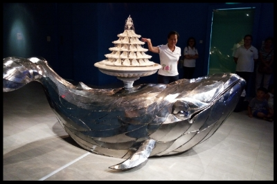 This art piece shows a whale with a tray of urinals, arranged as a fountain, as its blowhole.