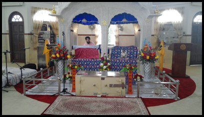 Inside the prayer hall where the Guru Granth Sahib (the holy book for Sikhs) is kept on a raised platform.