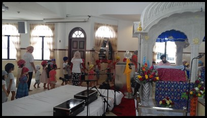 The children walk around the prayer hall.