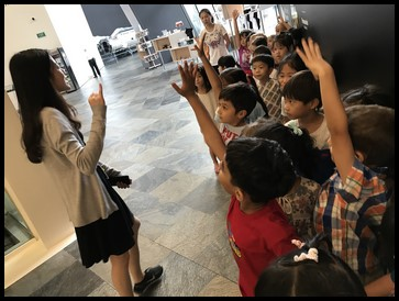 Before entering the exhibit, the children answered a few questions about museum etiquette.