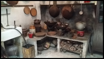 Kitchens were usually located at the back of the shophouse. Wood was used to start the fire for cooking.