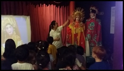 As not everyone could afford their own television, many would look watch the chinese opera.