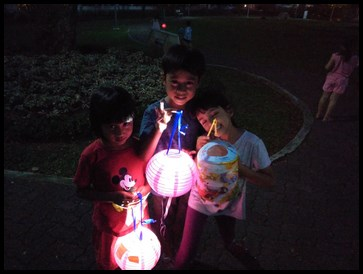Posing for a picture with their lanterns