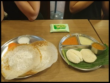 The parents also enjoyed their meal at Woodlands Madras. They had Appam and Idli.