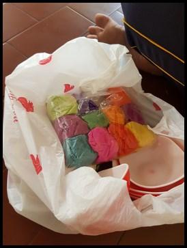 Rangoli powder in different colours.