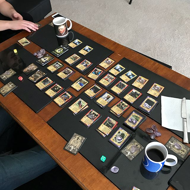 """Some good friends enjoying an epic battle of Knowledge! You can build the board however you want so this game had what we like to call """"the works"""" and of course Ja-Ru the Giant Eater made an appearance. (He's a giant alligator that eats dragons for breakfast) #gamenight #boardgames #indiegame #tabletopgames #cardgame"""