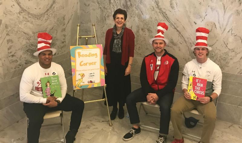 University of Utah football players Mason Woodward, Logan Bateman and Dakota Baker read to students at the Capitol.