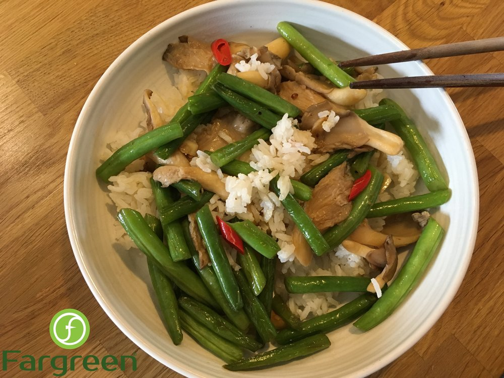 Oyster mushrooms and green beans stir-fry in soy sauce