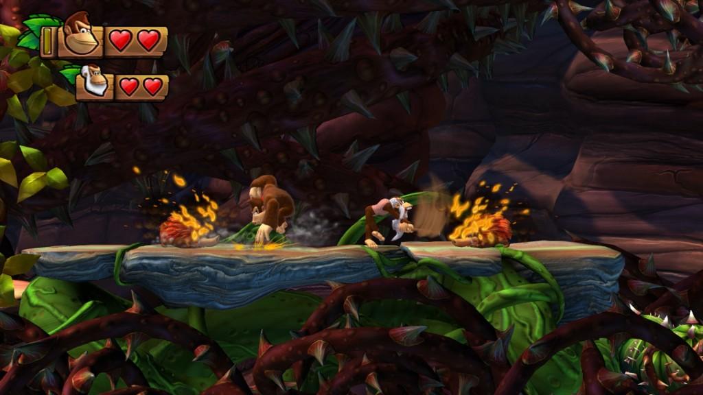 Anche qui DK può sbattere le manone per terra: questa mossa viene utilizzata come trigger per azionare interruttori ma anche per interagire con alcuni nemici, tipo questi!