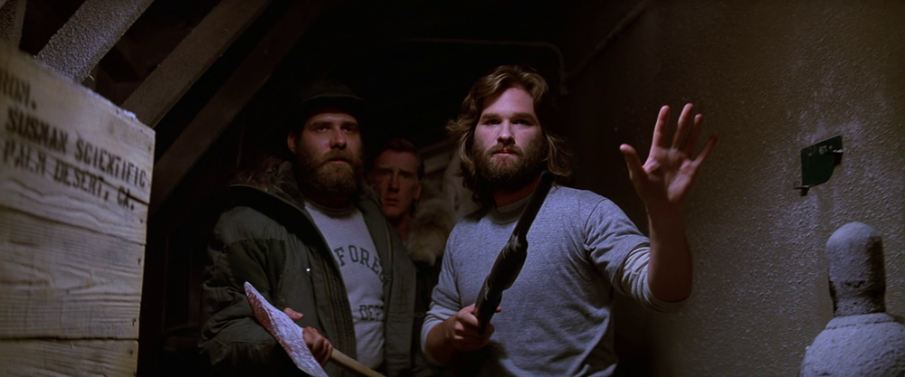 MacReady_and_Clark_approach_the_kennels_-_The_Thing_1982.png