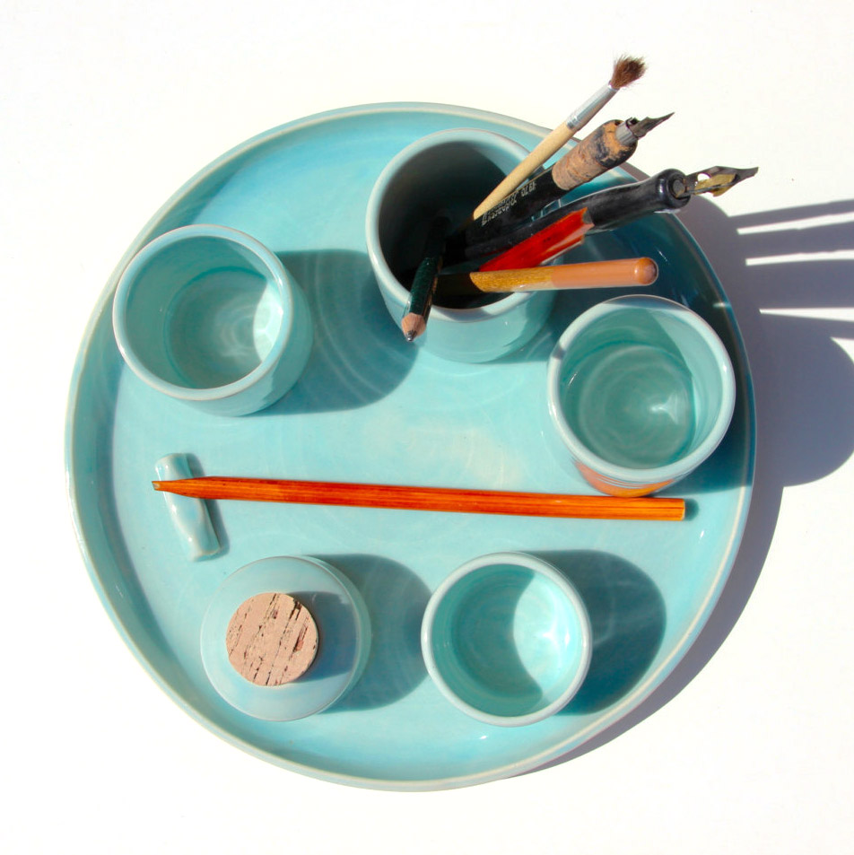 "<p><strong><a href=""https://www.etsy.com/listing/468027535/calligraphy-set-blue-ceramic-4-cups-1"" target=""_blank"">Kuzeh Pottery's Calligraphy Set</a></strong></p>"