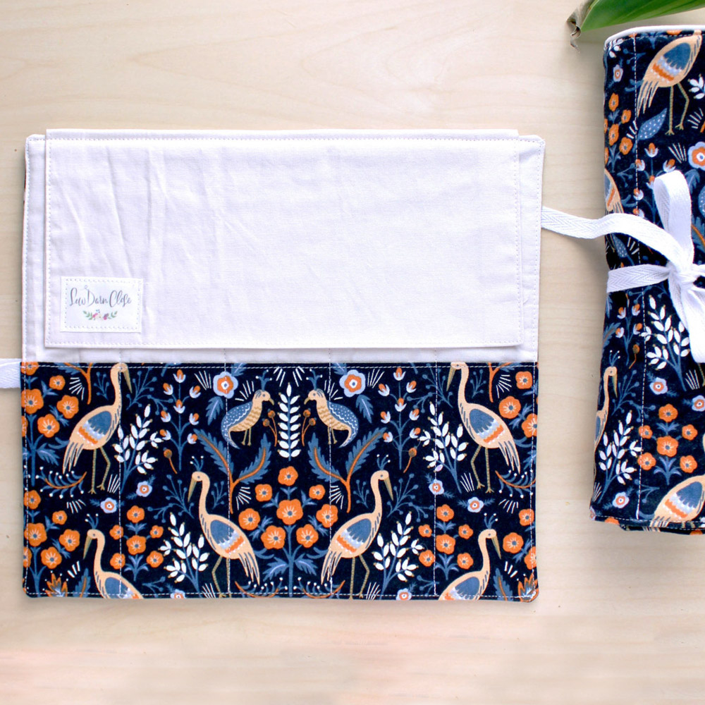 "<p><strong><a href=""https://www.etsy.com/shop/sewdarnclose?section_id=18985722"" target=""_blank"">Sew Darn Close's Pen Roll</a></strong></p>"