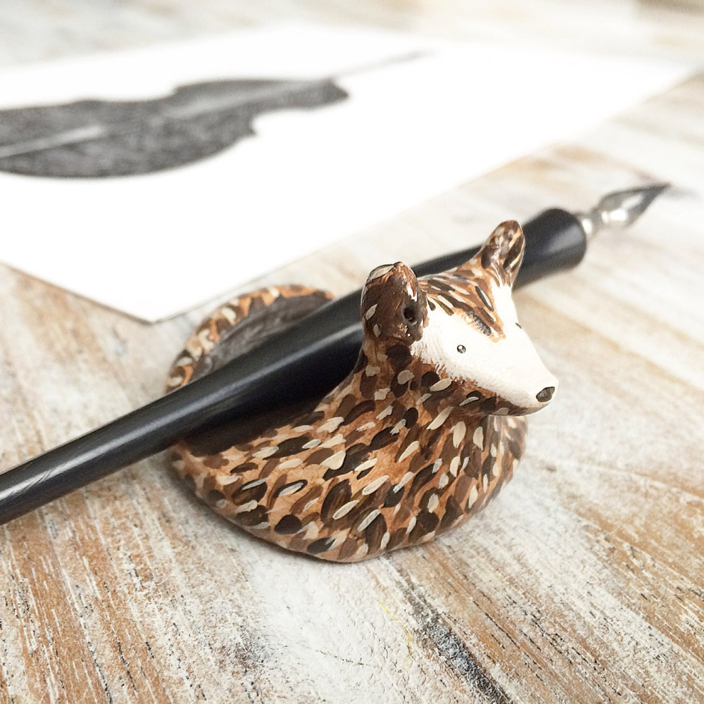 "<p><strong><a href=""https://www.etsy.com/listing/385486296/calligraphy-pen-rest-free-usa-shipping?ref=shop_home_active_4"" target=""_blank"">Loosh Art's Clay Deer Pen Rest</a></strong></p>"